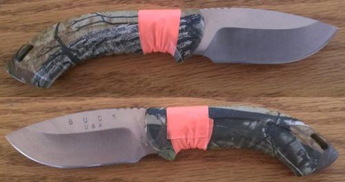 camo knife handle wrapped in blaze orange trail marking tape
