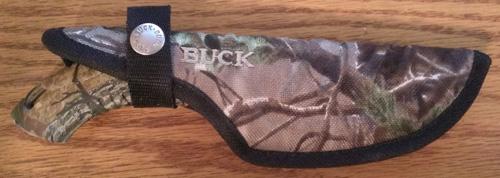sheathed camo buck knife